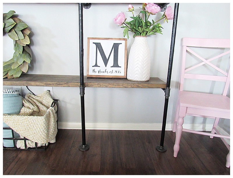 industrial shelving pink chair decor
